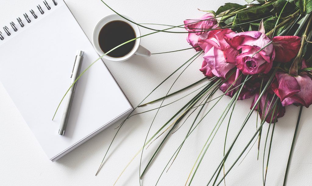 Flowers and coffee on table