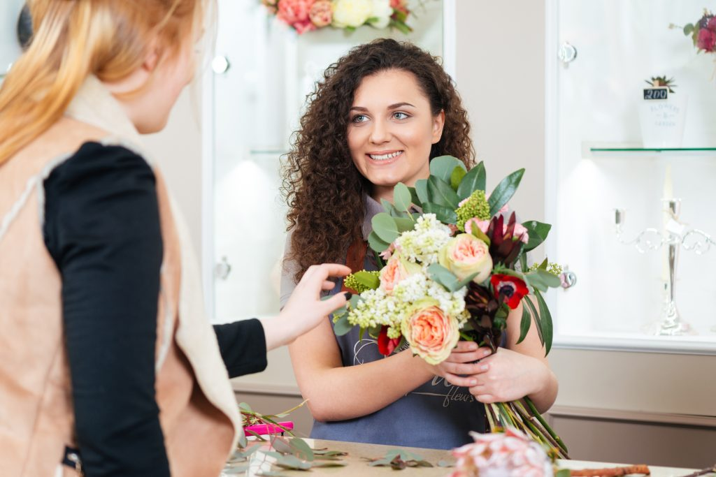 Florist holding Flowers - Lovingly Moment Makers