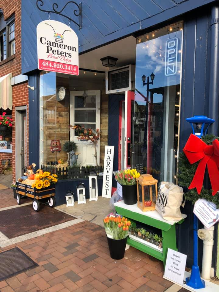 Attractive floral shop window of owner Cameron Peters in Phoenixville, PA.
