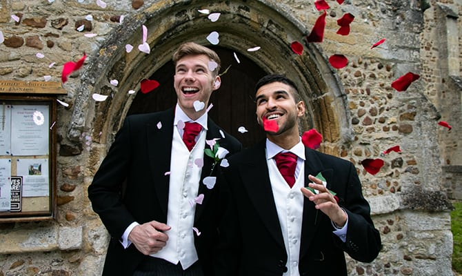 Gay wedding with two grooms celebrating