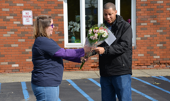 Man receiving Petal It Forward flowers