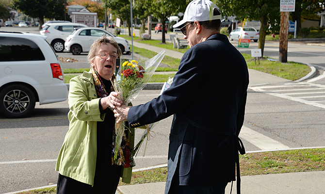 Woman receiving Petal It Forward flowers