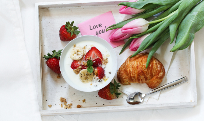 Breakfast in bed for Valentines with strawberries and tulips