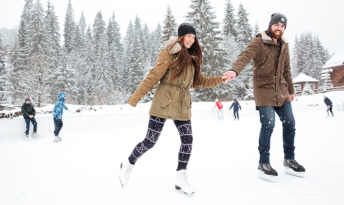 Couple ice skating on a date