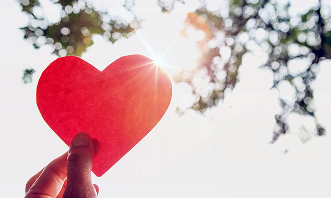 Paper heart in sky