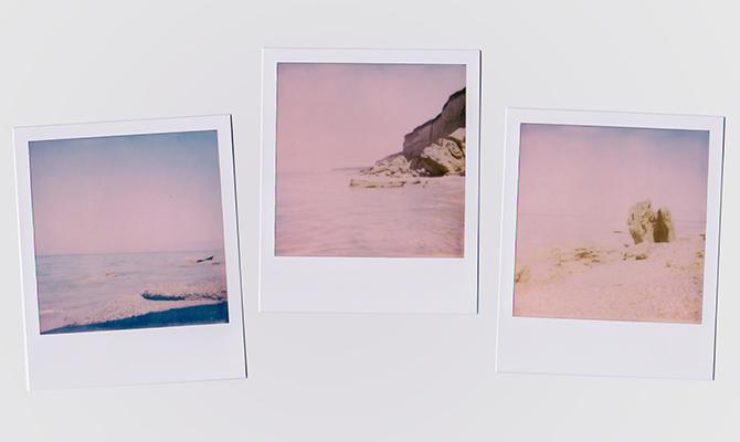 Polaroid photos on wall