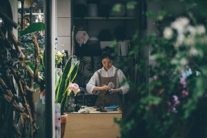 local florist working in flower shop